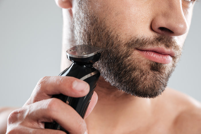 young man using shaving beard