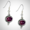 Image of Sterling Silver Southwest Amethyst Oval Earrings With Roped Border