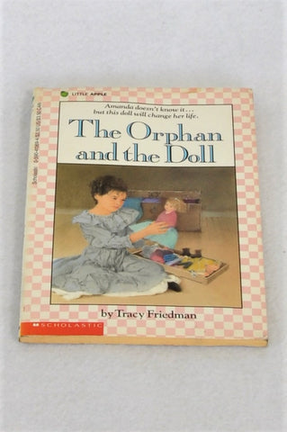 Scholastic The Orphan And The Doll Softcover Book Unisex 4-10 years