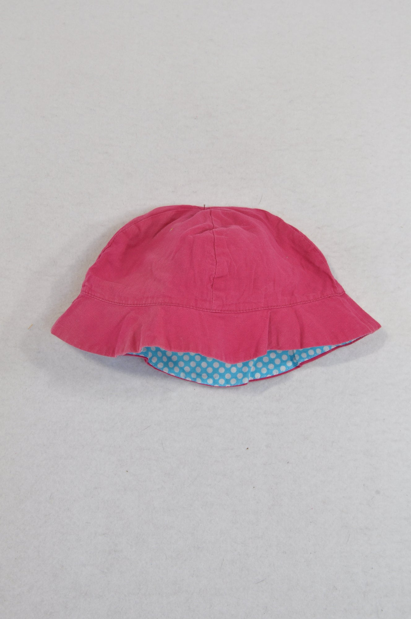Unbranded Cerise Reversible Blue Dotty Hat Girls 3-6 months