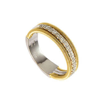 Row of diamonds encased by yellow gold ring