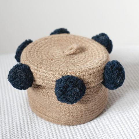 Dinki Human Braided jute basket with navy pom-pom trim
