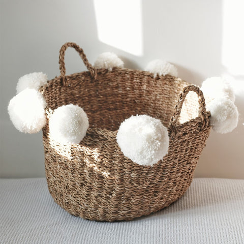 Dinki Human Braided jute basket with pom-pom trim, nursery storage