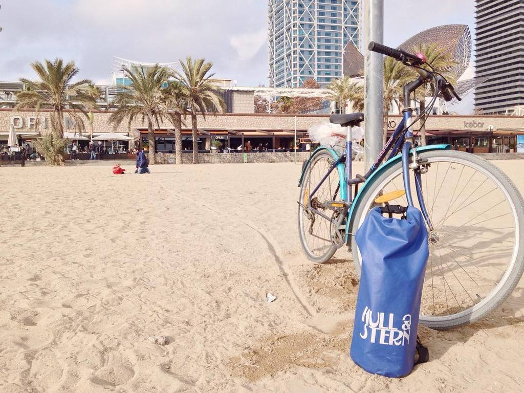 Hull & Stern Dry Bag at Barceloneta Beach in Barcelona, Spain