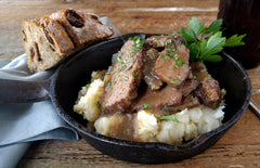 Grilled  Boneless Beef Short Ribs, sliced, in a Red Wine Demi-Glace with Poutine Smashed Potatoes