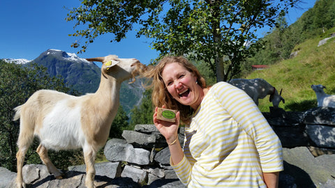 Gannage family holding goat milk bar of soap next to goat