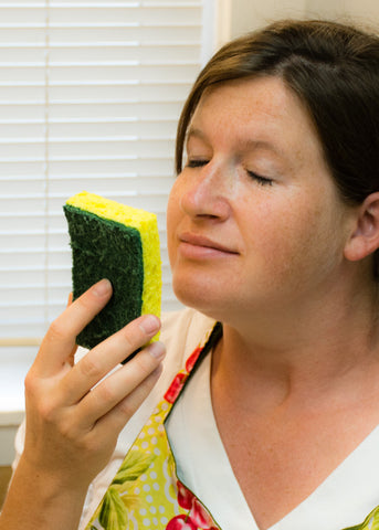 Co-founder Marilee Johnson smelling a clean dish sponge
