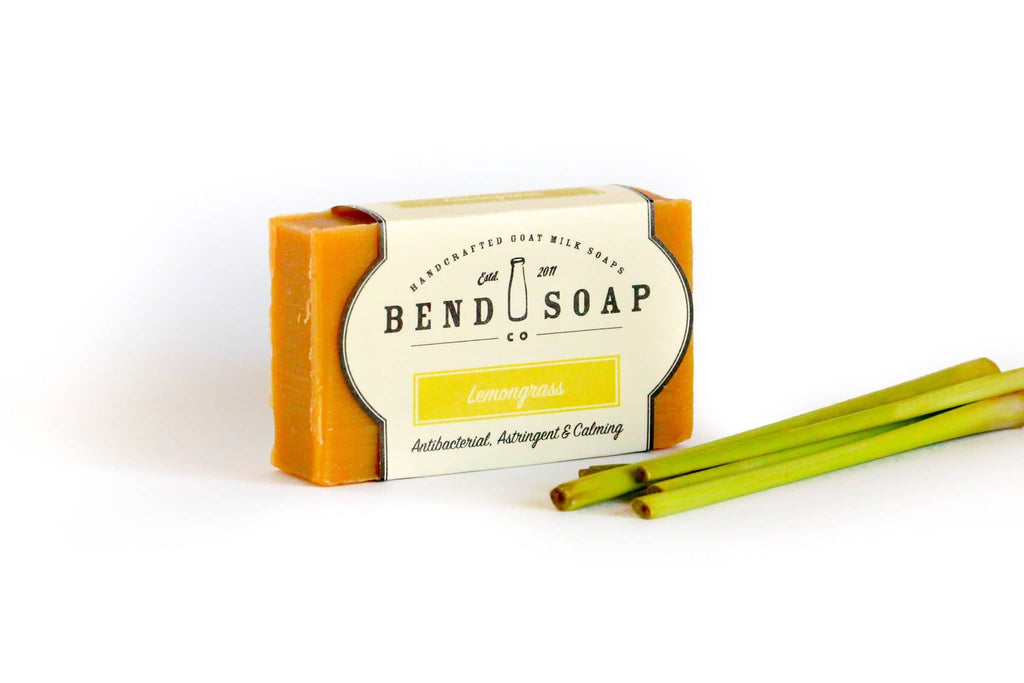Full Size Lemongrass bar of soap wrapped in Lemongrass label next to lemongrass stems