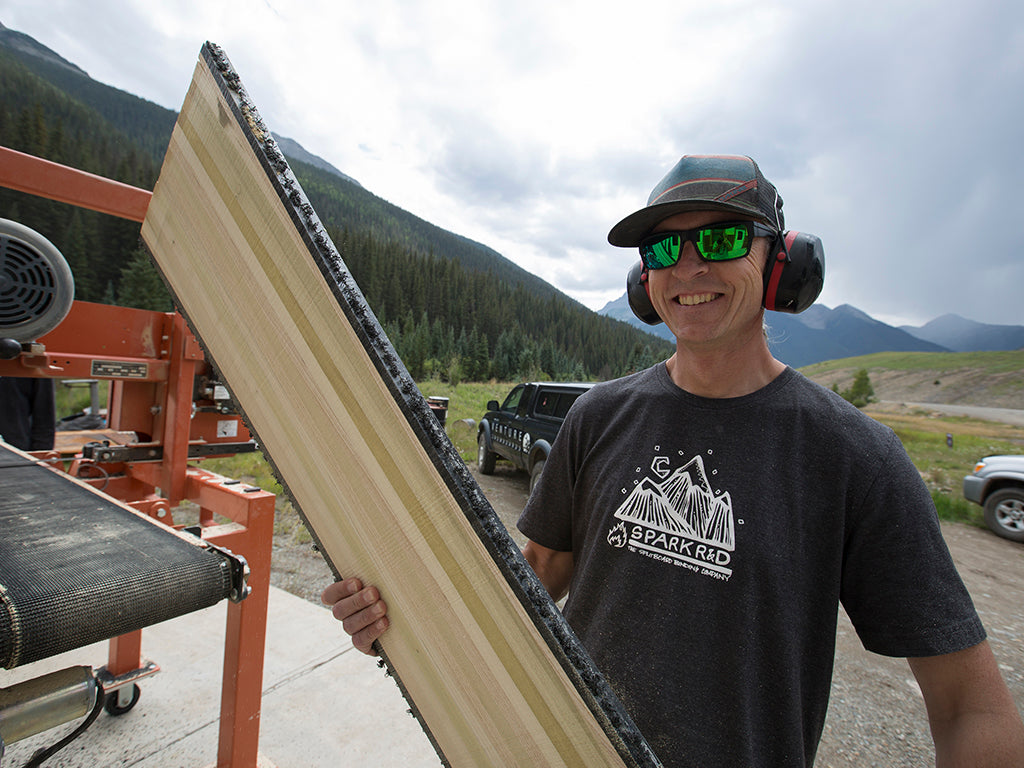 Venture's Klem Branner showing off a handcrafted snowboard core.