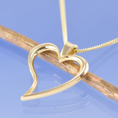 Melt your own wedding ring or rings into this heart