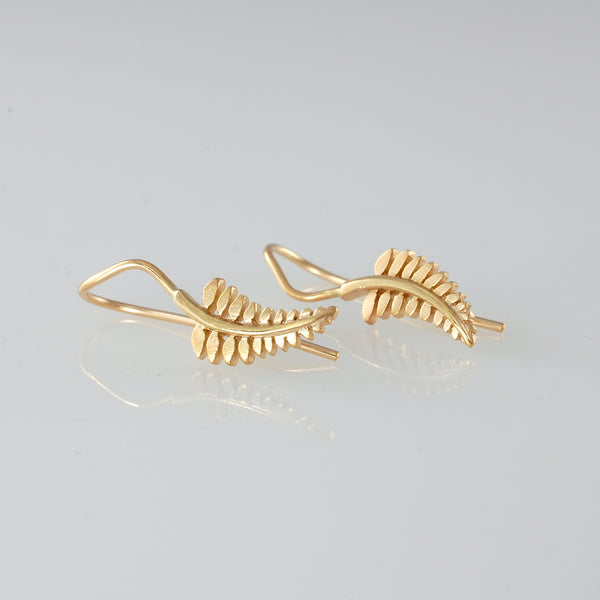 silver fern earrings in gold by Jewel Beetle