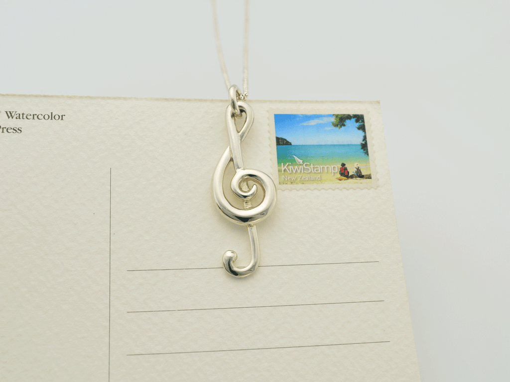 treble clef pendant on size sample