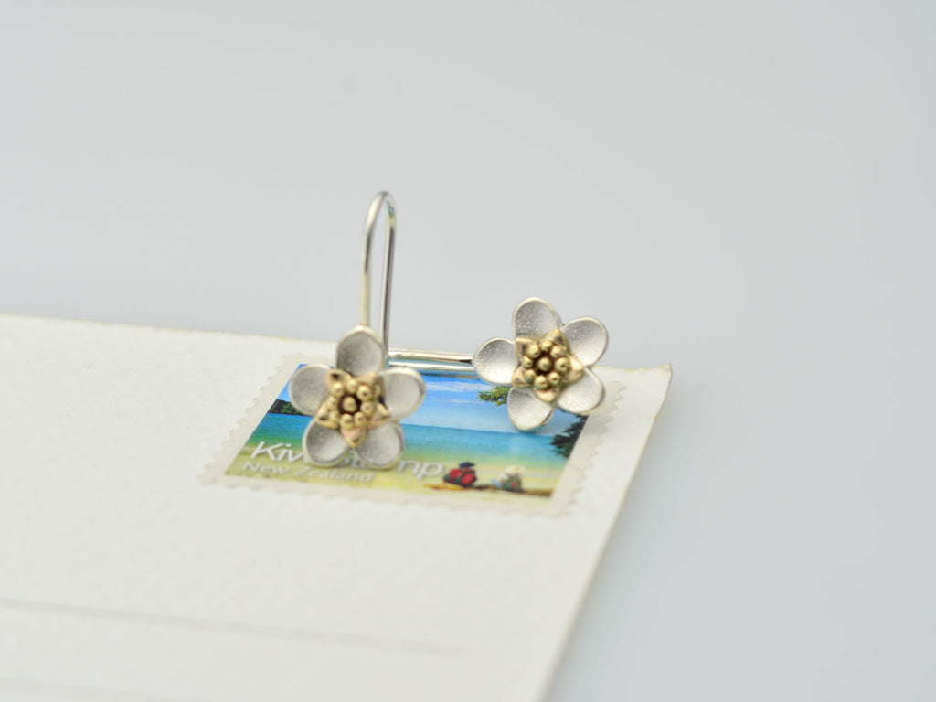 silver manuka flower drop earrings with 9ct yellow gold center with size sample