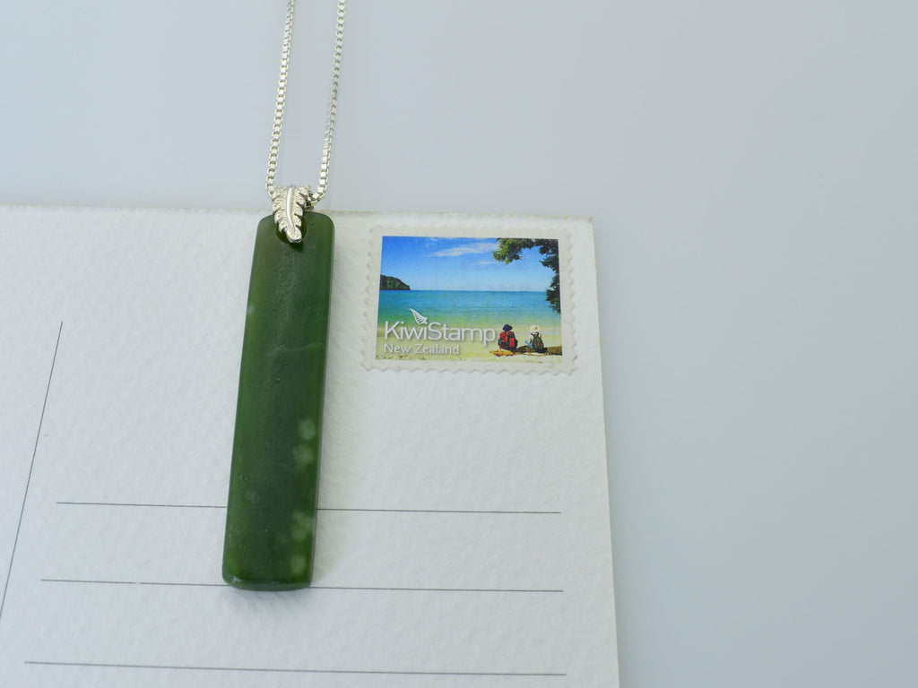 greenstone pendant with fern bail on stamp
