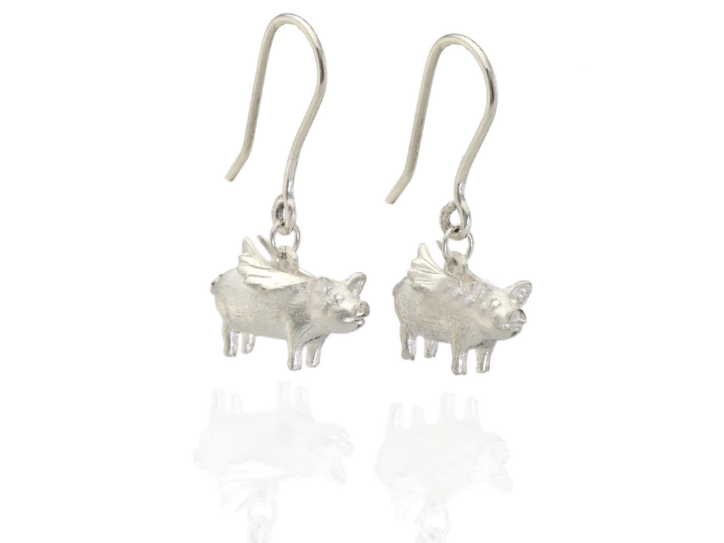 flying pig earrings in silver