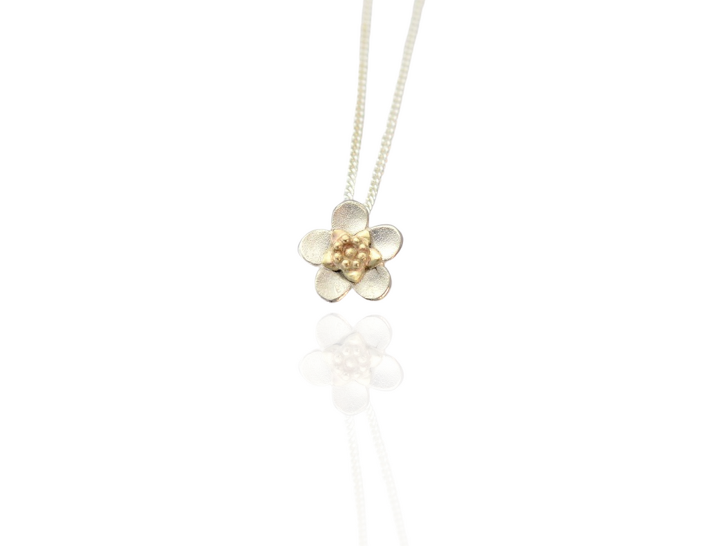 manuka flower pendant in silver and gold