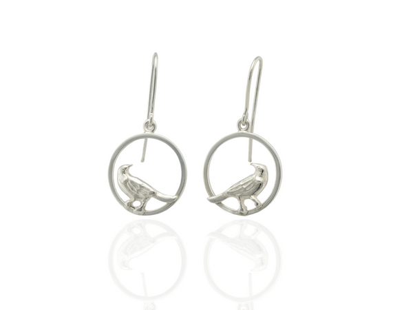 tui bird circle earrings in silver