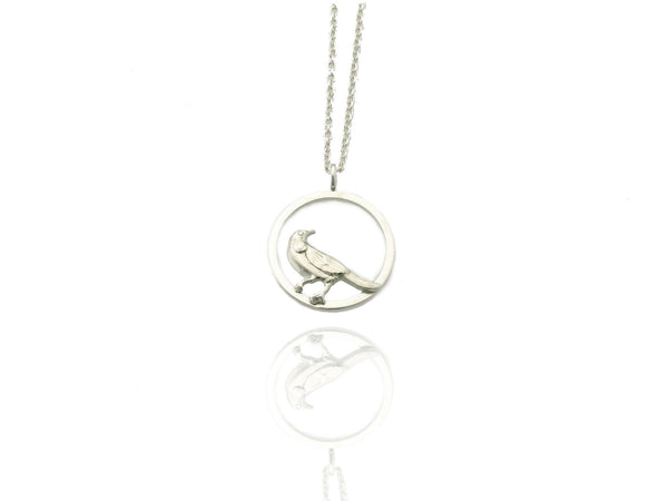 tui bird circle pendant silver