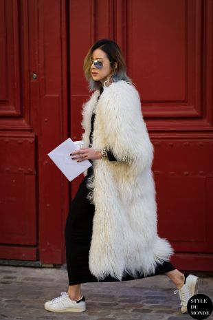 cream long faux fur coat with trainers