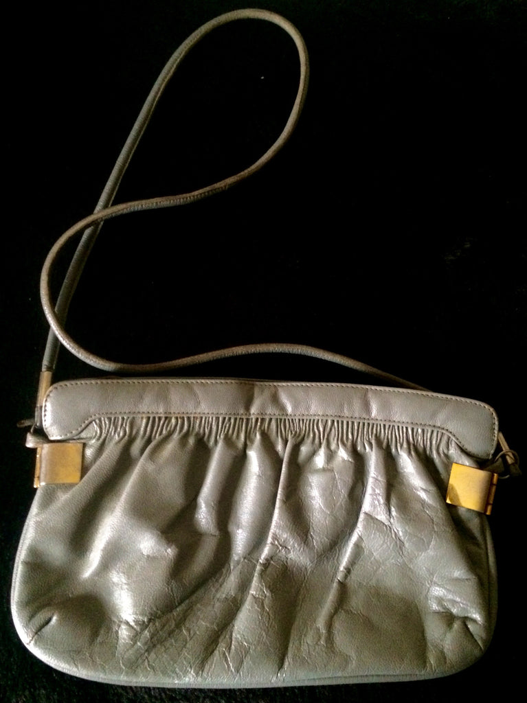 Vintage 1970s leather shoulder bag with gold clasp
