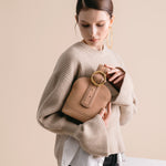 Addicted Brogue Bracelet Bag in Beige | Parisa Wang | Featured