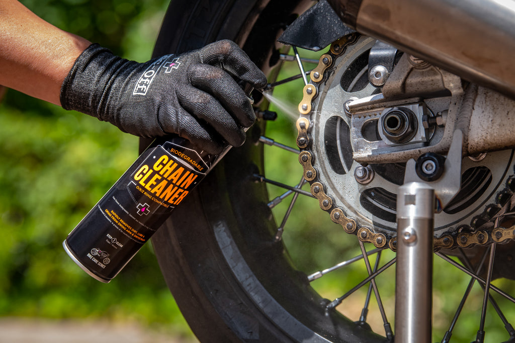 Applying Muc-Off Chain Cleaner to motorcycle