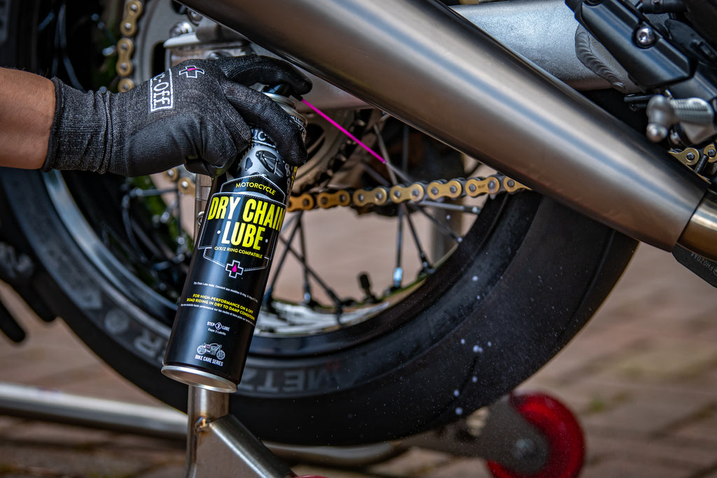 Applying Dry Chain Lube to a motorcycle