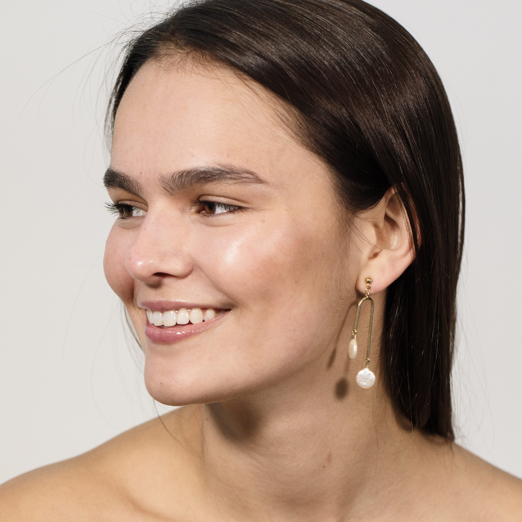 The Riera Earrings by Montserrat New York featuring 10mm white freshwater pearls