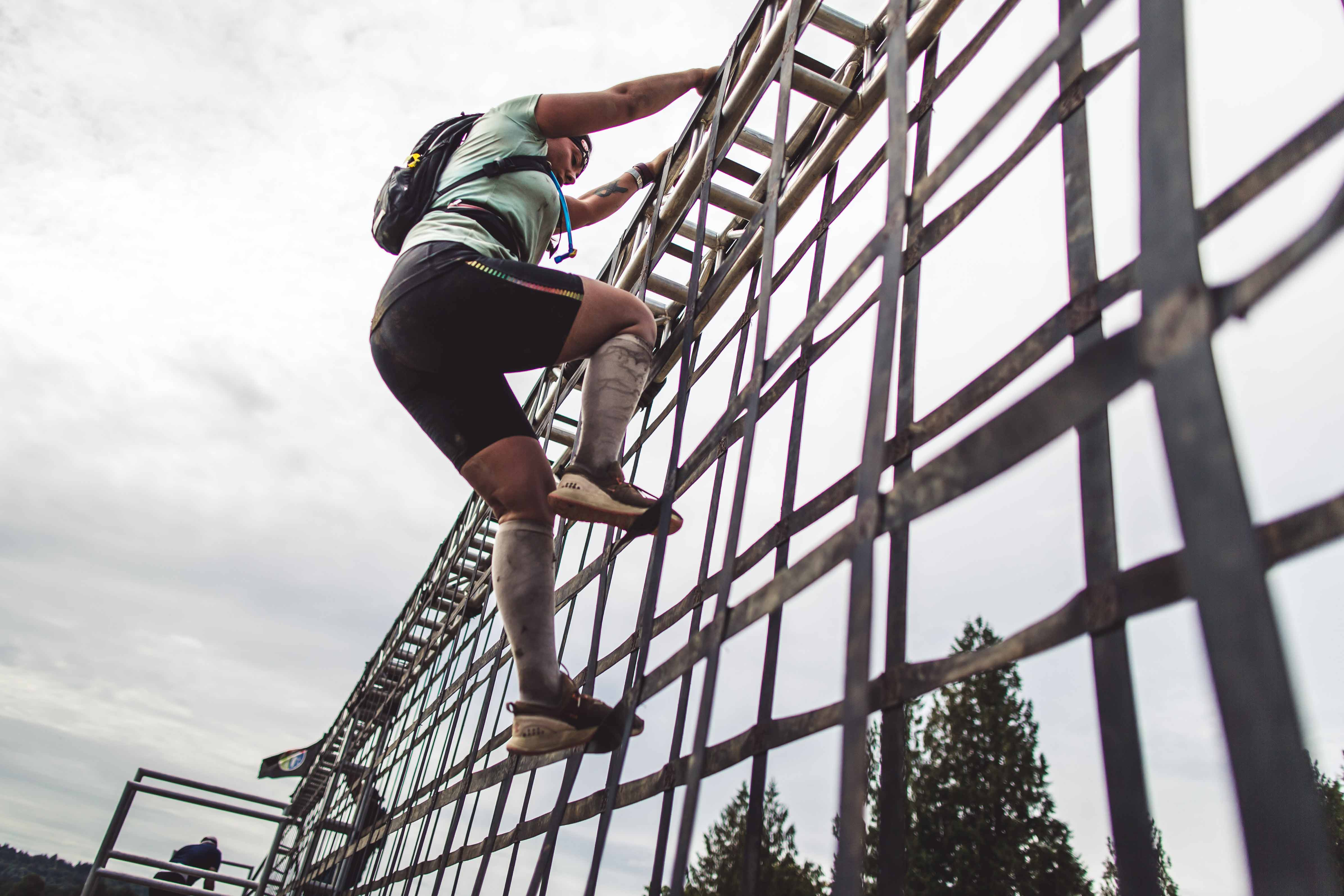 After preparing with ankle stability exercises, a Spartan racer completes an obstacle.