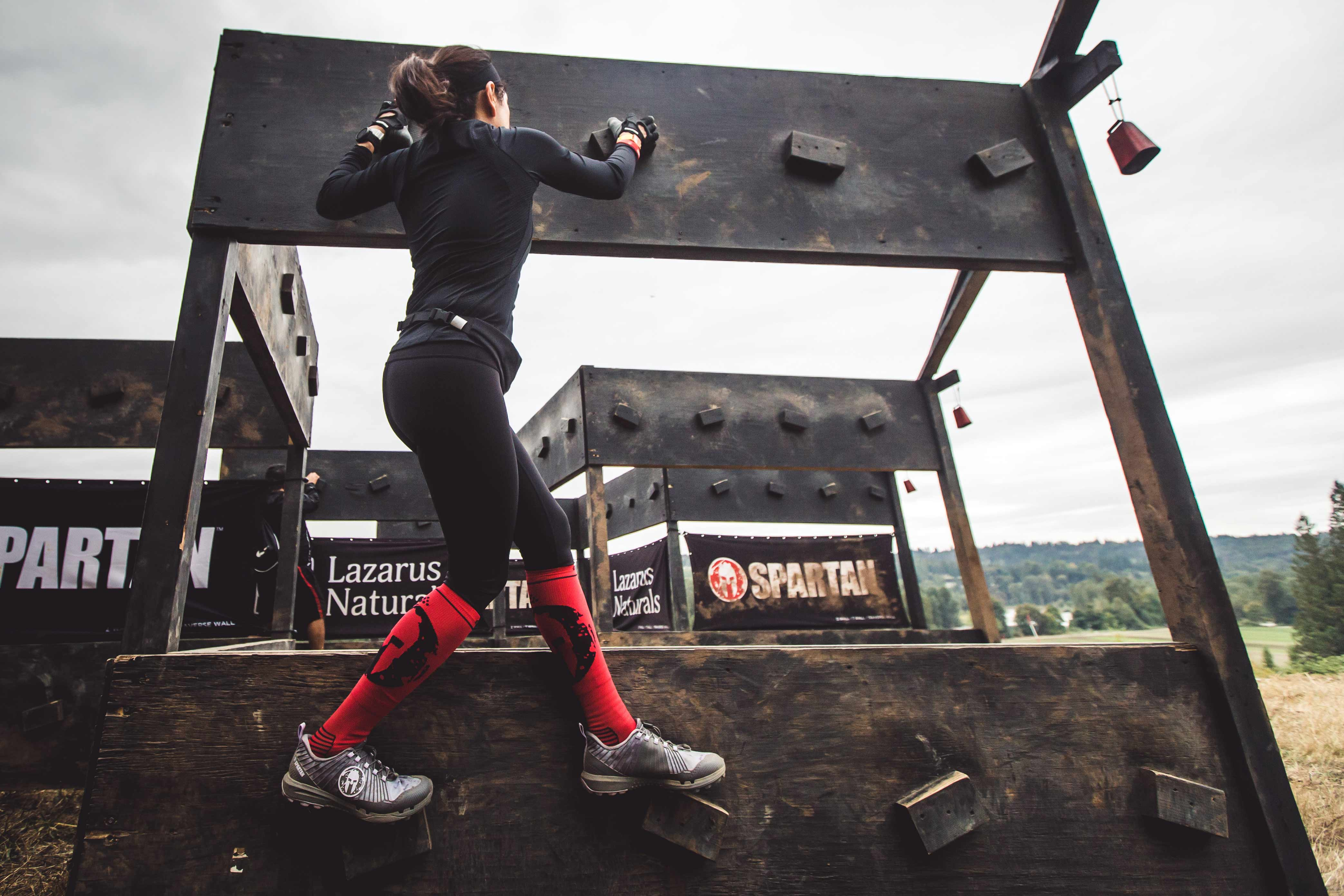 having prepared with ankle stability exercises, a Spartan racer completes an obstacle with no injuries