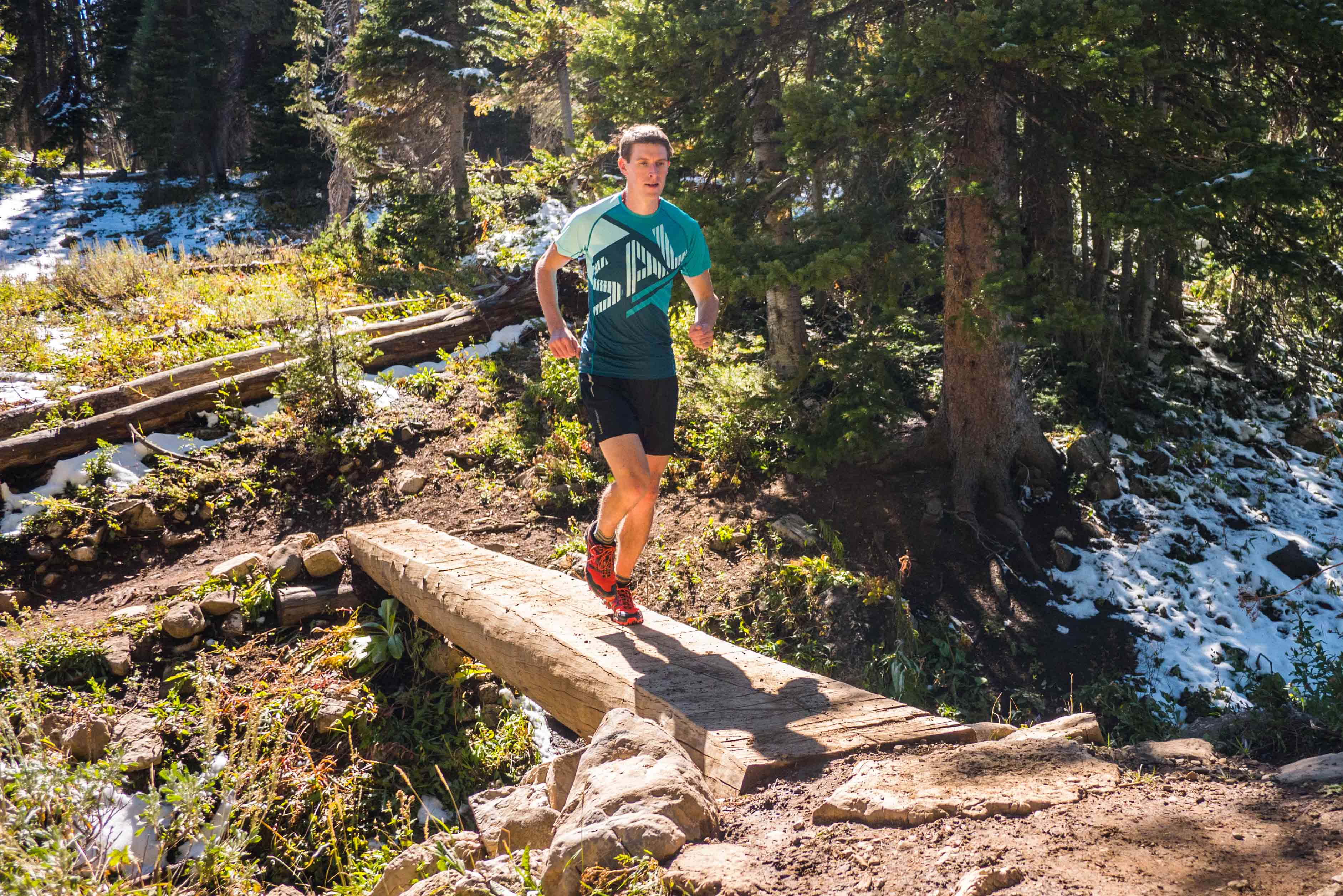Ian Hosek uses an endurance nutrition plan to fuel his training and elite racing through a wooded area and over a creek