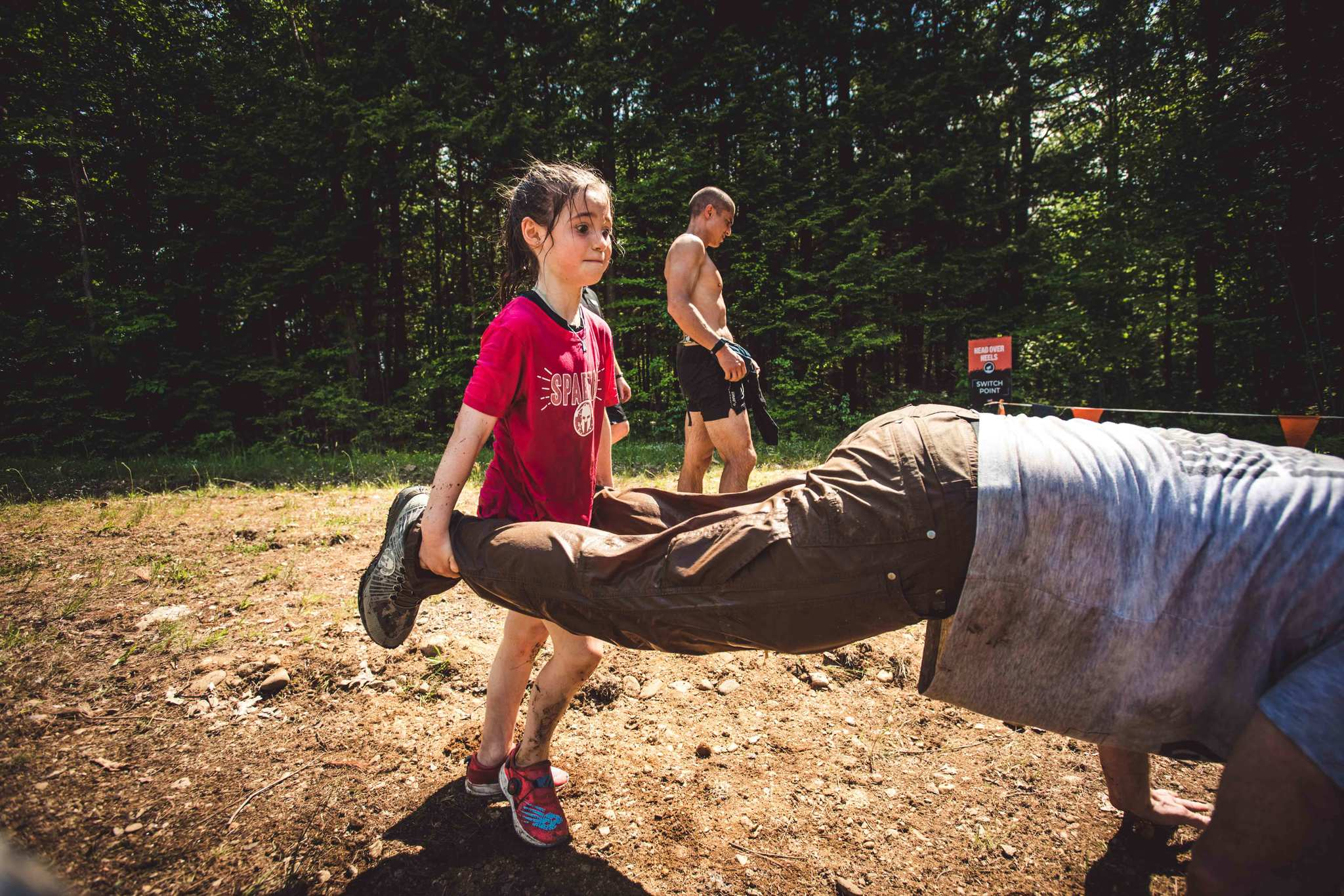 One of the five toughest people in the Joe De Sena network, Joe's youngest daughter Alex, completes a race while holding Joe's feet.