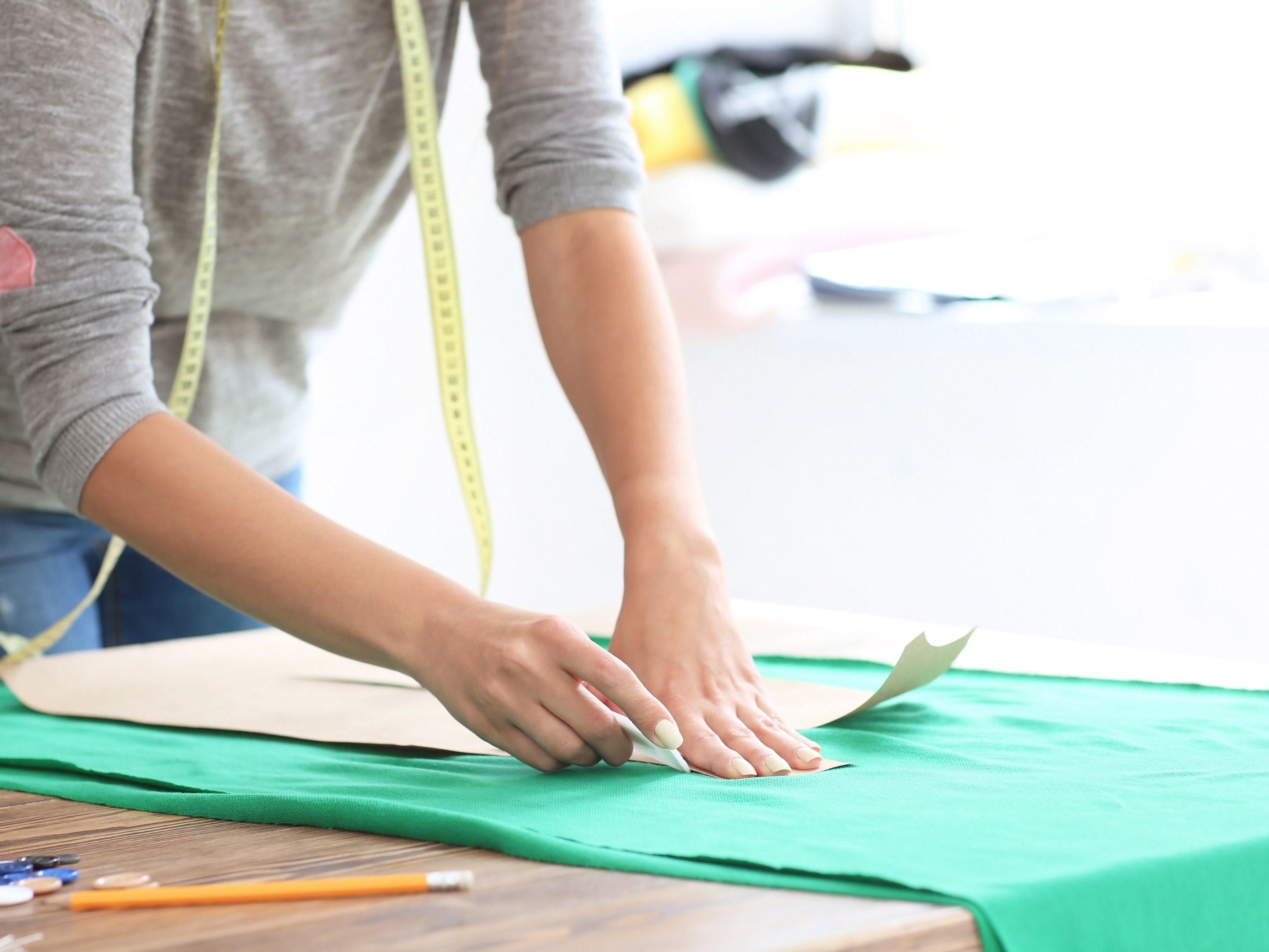 Sewist Cutting Out Fabric With a Pattern
