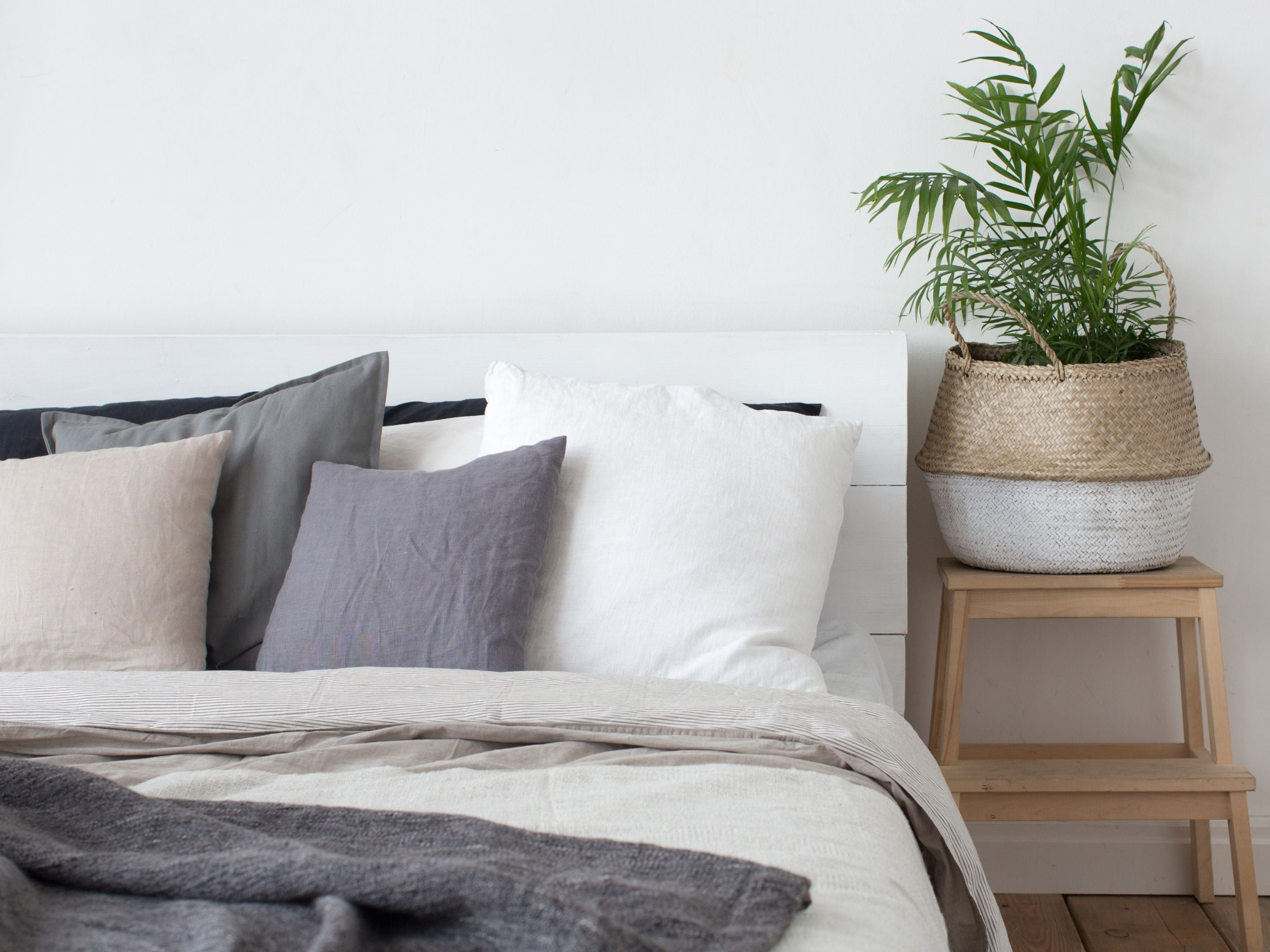 Linen pillowcases and bedding on a made bed