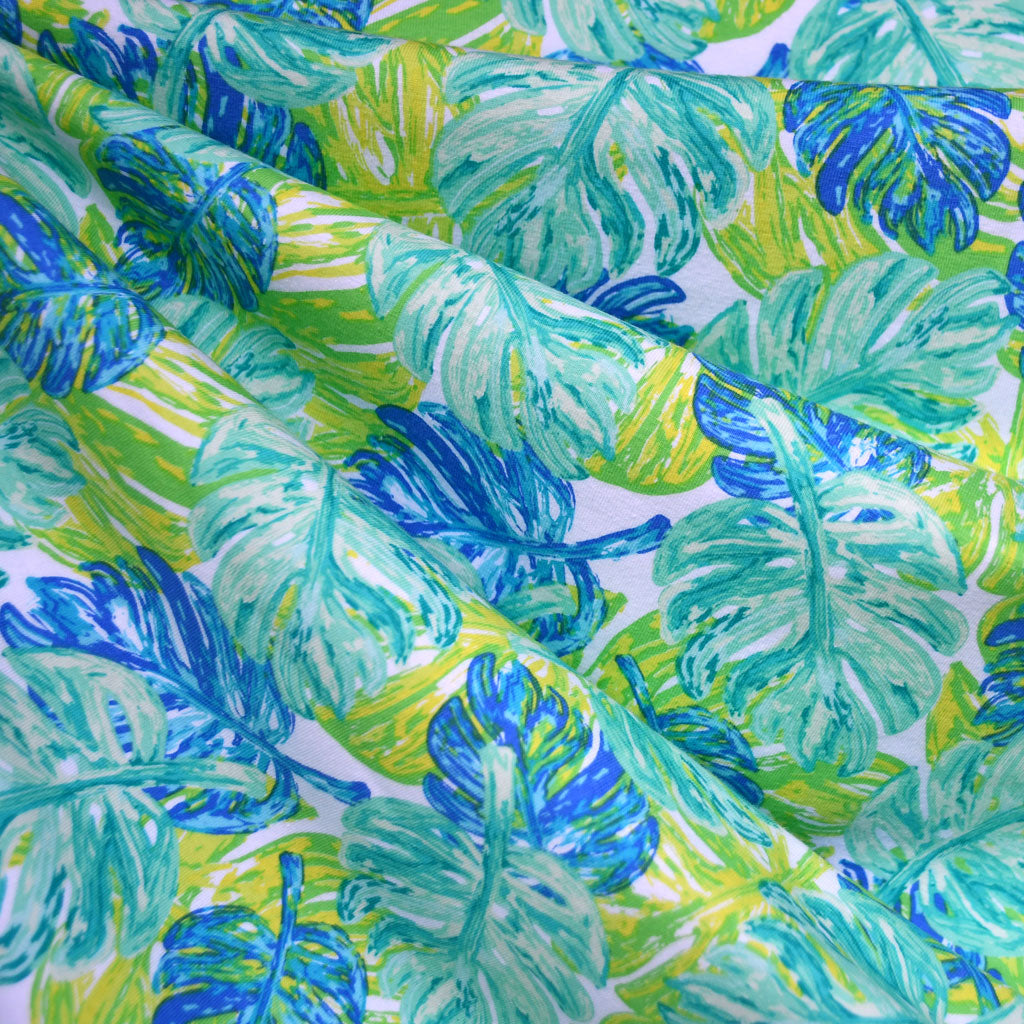 West Palm Leaf Collage Jersey Knit Aqua/Lime SY - Selvage Yard - Style Maker Fabrics