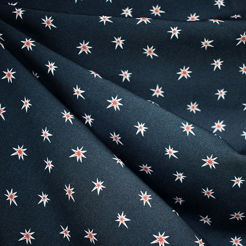 Life in Pattern Bursting Stars Rayon Navy