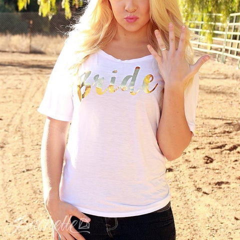 "These adorable goil-foil slouchy ""bride"" tees are the cutest! Perfect for showing off your newly engaged status, bachelorette parties, wedding day, or honeymoon! Available at bachette.com!"