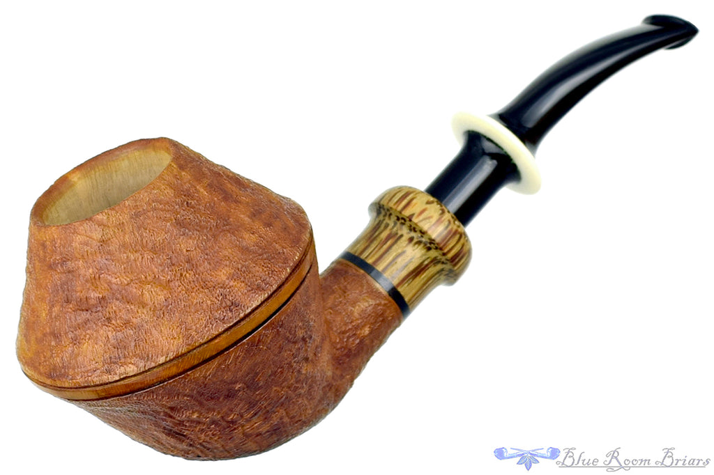 Blue Room Briars is proud to present this Ron Powell Pipe 1/8 Bent Sandblast Rhodesian Sitter with Red Palm Ferrule and Ivorite Stem Insert