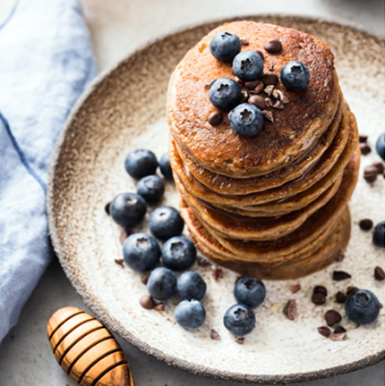 gluten free protein pancakes with blueberry and chocolate chip topping