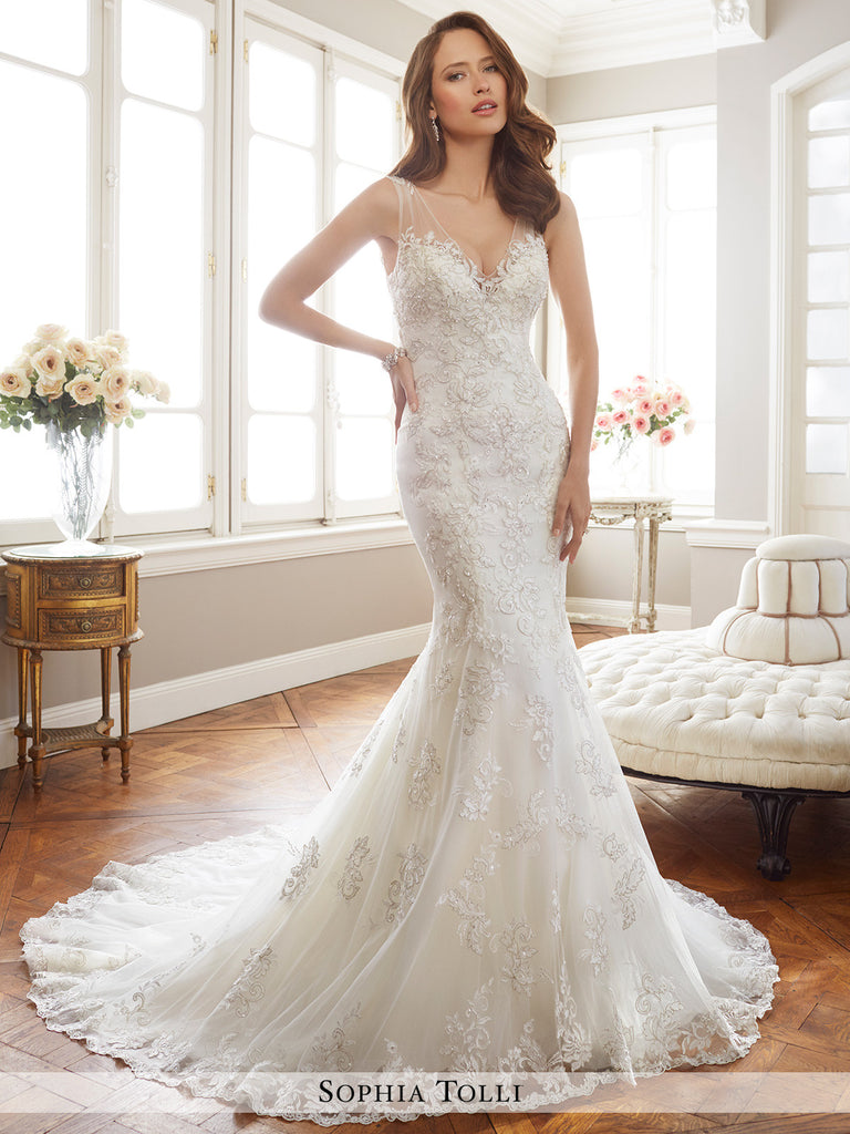 Sophia Tolli misty tulle over soft satin mermaid with illusion shoulder straps and deep V-neckline sleeveless  wedding gown