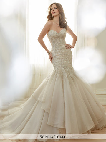 Sophia Tolli strapless fantasy organza trumpe features a sweetheart neckline wedding gown