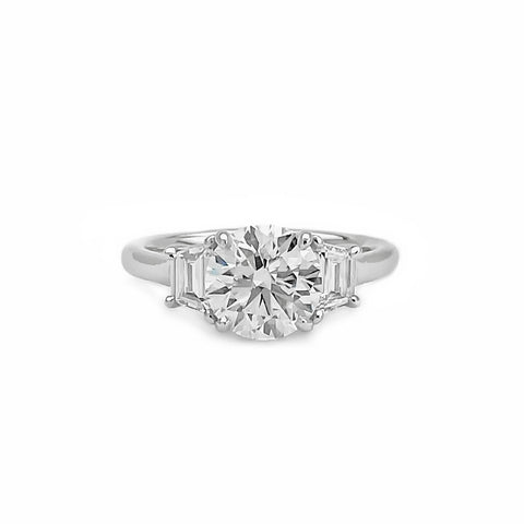 Platinum Round Brilliant Cut Diamond Ring with Trapezoids