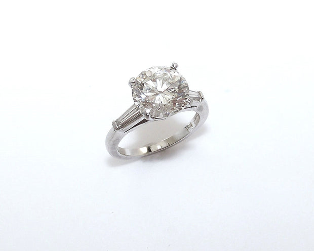 Round Brilliant Diamond and Platinum Ring with Tapered Baguettes