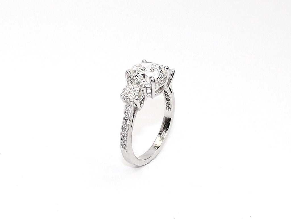 Three Stone Round Brilliant Diamond and Platinum Ring