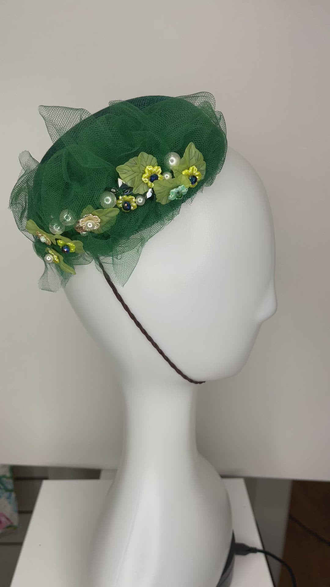 Green embellished hand blocked cocktail hat