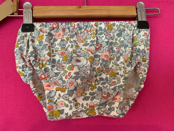 Liberty print baby bloomer pants on a coat hanger