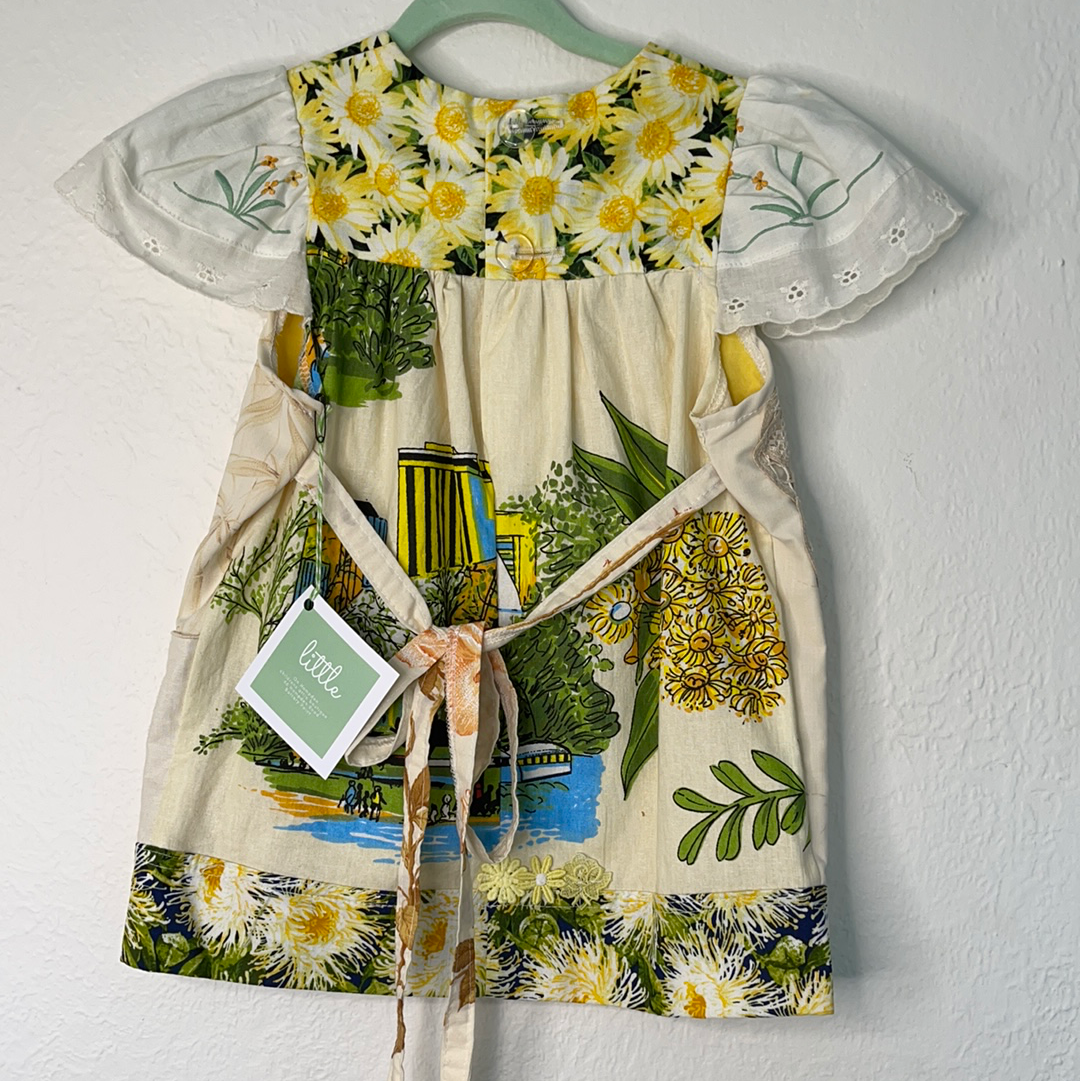 Back of Baby's Vintage yellow and white floral tunic
