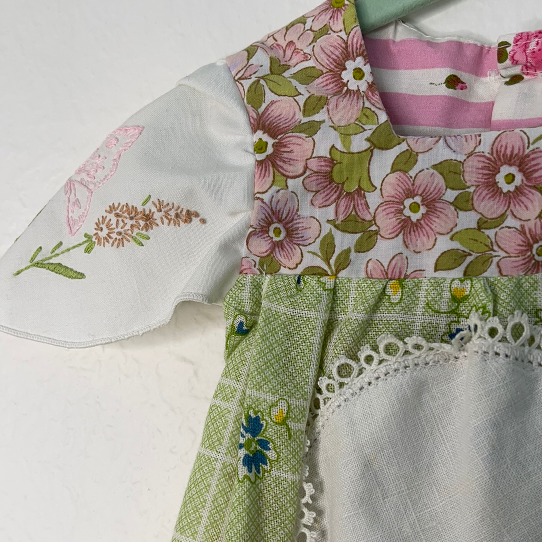 Right shoulder of Baby's green and pink vintage floral tunic