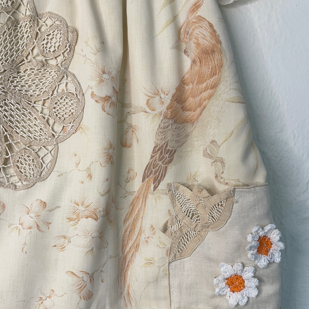 Close up of Baby's Vintage yellow and white floral tunic