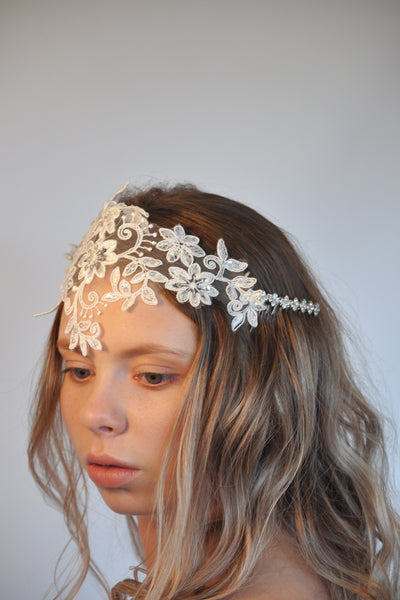Girl looking away from camera wearing white flowery headpiece